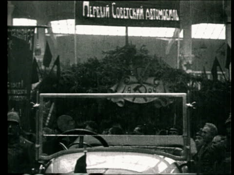 1925 b/w ms td early soviet car on display in workshop during development of soviet car industry/ russia - cyrillic script stock videos & royalty-free footage
