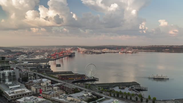 early summer morning ews time lapse of cumulus clouds rolling over elliot bay with commuter ferry traffic in the foreground - filiz stock videos & royalty-free footage
