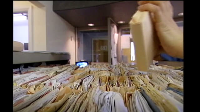 nhs early treatment plans unveiled file dates locations unknown int close shot of medical records in filing cabinet flicked through - filing cabinet stock videos & royalty-free footage