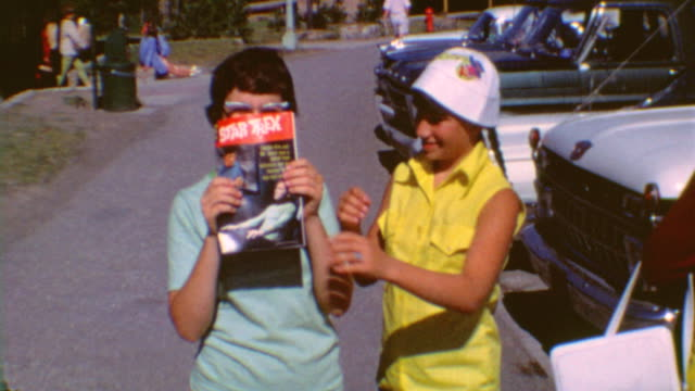 early trekkies holding star trek comic book / showing book to camera / star trek comic five on september 01, 1967 in los angeles, california - zeitschrift stock-videos und b-roll-filmmaterial