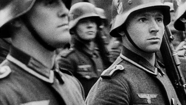 stockvideo's en b-roll-footage met b/w montage early world war ii combat showing nazi rally in germany and devastation in czechoslovakia, poland, norway, holland, belgium, and france / europe - duitsland