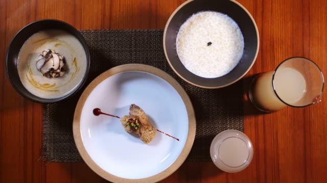 early-ripening rice 'tarakjuk' (korean milk porridge) and fried 'kodari' (semi-dried pollock fish) in rice recipe - pollock fish stock videos & royalty-free footage