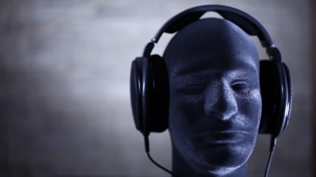 earphones on mannequin's head - mannequin stock videos & royalty-free footage