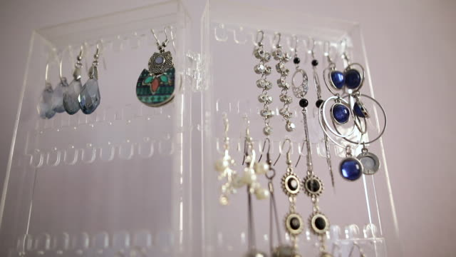 earrings hanging on the stand in in jewelry store - precious gem stock videos & royalty-free footage
