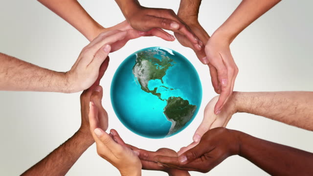 earth and hands in a circle. loopable f111/f605. green. - caucasian ethnicity bildbanksvideor och videomaterial från bakom kulisserna