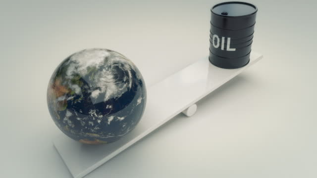 earth and oil barrell on seesaw - comparison stock videos and b-roll footage