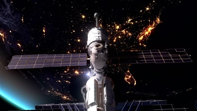 us earth at night city lights and iss satellite 4k - satellite video stock e b–roll
