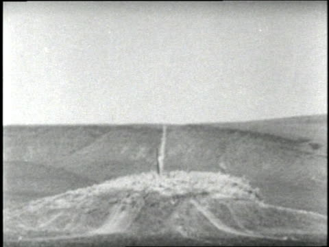 Earth explodes in clouds of dust during an underground atomic bomb test