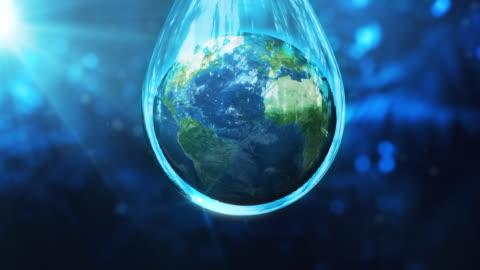 earth globe in a water drop - drop stock videos & royalty-free footage