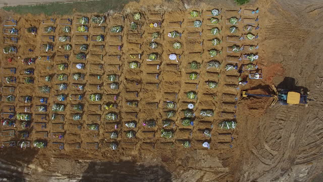 earth mover digging graves for covid-19 victims, aerial view in manaus, amazonas state, brazil, on sunday, january 17, 2021. - digging stock videos & royalty-free footage