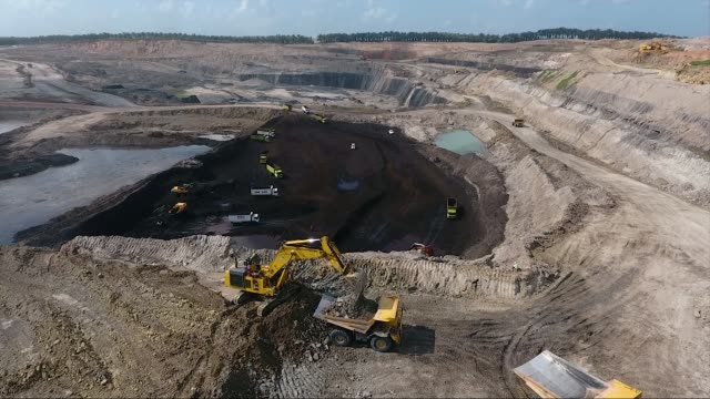 earth mover loading a truck at a coal mine - quarry stock videos & royalty-free footage