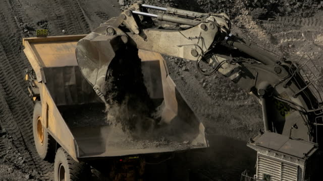 earth mover loading a truck at a coal mine - mining stock videos & royalty-free footage