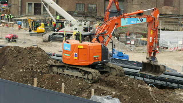 ws earth mover on pile of dirt at construction site in battersea / london, england, united kingdom - bulldozer stock videos and b-roll footage