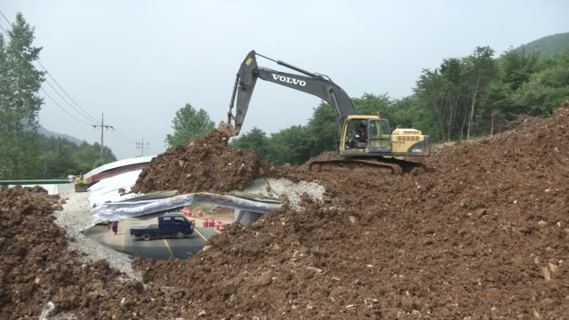 earth mover restoring collapsed ecological tunnel - bulldozer stock videos and b-roll footage