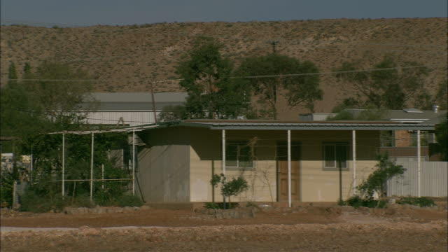 earth moving equipment is parked in the driveway of a home in coober pedy. - coober pedy stock videos & royalty-free footage