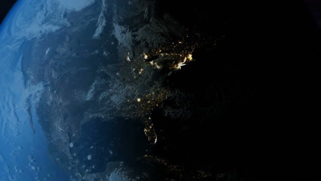 earth rotates from day into night as city lights come on. - day stock videos & royalty-free footage