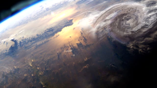 earth surface seen from space. northern lights and hurricane. nasa public domain imagery - natural disaster stock videos & royalty-free footage