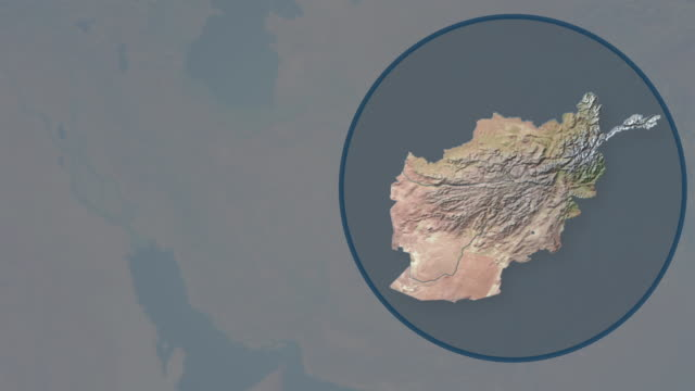 earth zoom on afghanistan and is cut out and placed in blue circle - zoom in stock videos & royalty-free footage