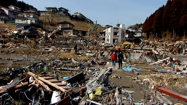 earthquake and tsunami aftermath: rikuzen-takata: gvs of damage to town / rescue workers / interviews with survivors; wide shot flattened landscape,... - earthquake stock videos & royalty-free footage