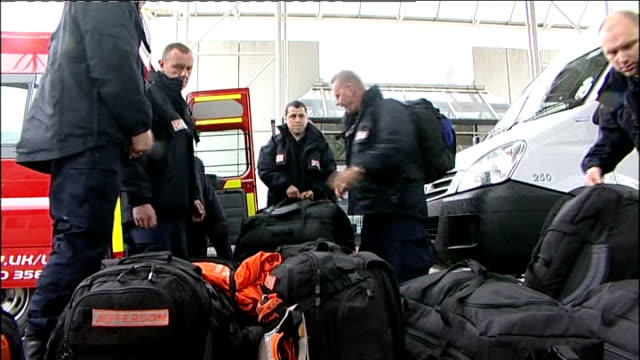 UK Rescue team leaves for Japan ENGLAND Manchester EXT Convoy of emergency service vehicles arriving at airport / Emergency workers from vehicles /...