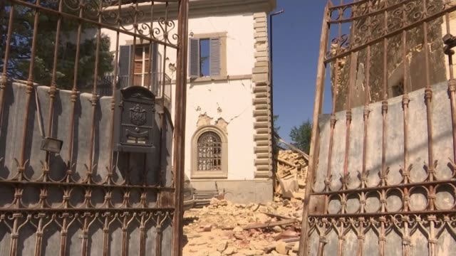 Day of mourning as three British victims named ITALY Sommati EXT GVs remaining facade of collapsed apartment building