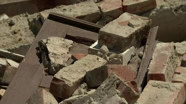 Earthquake death toll rises Lorenzo interview SOT always hope to find people alive but in reality we find bodies Close shots of rubble from collapse...