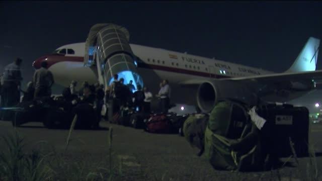 International aid flights delayed due to congestion and damage at Kathmandu airport INDIA Delhi Passengers boarding Spanish military plane on tarmac...