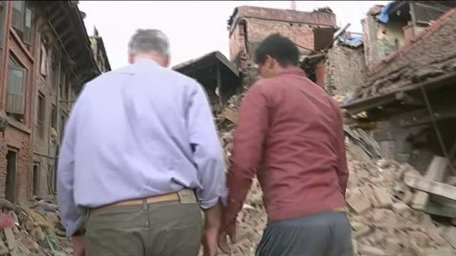 report from bhaktapur nepal bhaktapur ancient temple pile of rubble beside temple destroyed temple shia laxmi digging in rubble laxmi pointing to... - ダメージ点の映像素材/bロール