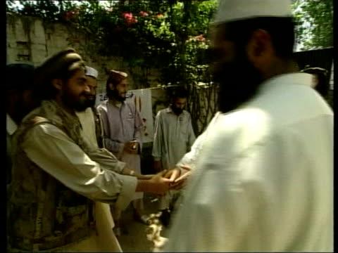 participation of militant groups TX Peshawar Bakht Zamin greeting Mujahideen recruits at recruitment centre