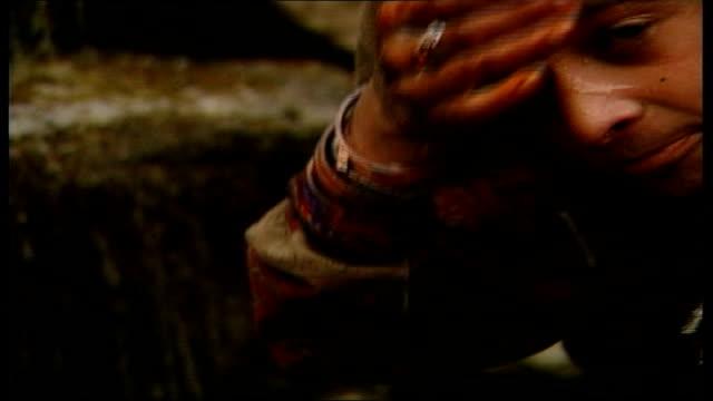 vídeos de stock, filmes e b-roll de victims suffer in winter weather pakistan moori patan children inside tent cs young girl lying under sleeping bag cs child putting on wet shoes i/c... - water form