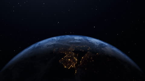 earth's rotation loop with night side city lights - planet earth stock videos & royalty-free footage