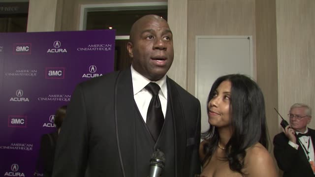Earvin 'Magic' Johnson and Cookie Johnson on how they know Samuel L Jackson and on Samuel L Jackson's successful career at the 2008 Presentation of...