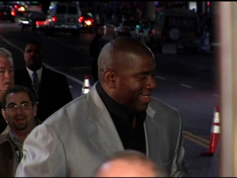 earvin 'magic' johnson and earleatha 'cookie' kelly at the 'be cool' los angeles premiere at grauman's chinese theatre in hollywood california on... - magic johnson stock-videos und b-roll-filmmaterial