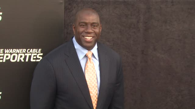 earvin 'magic' johnson at time warner sports celebrates launch of time warner cable sportsnet and time warner cable deportes networks on 10/1/2012 in... - マジック・ジョンソン点の映像素材/bロール