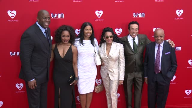 Earvin 'Magic' Johnson Smokey Robinson Berry Gordy and Angela Bassett at the 12th Annual MusiCares Map Fun Benefit Concert Honoring Smokey Robinson...