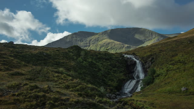 eas a' bhradain waterfall and marsco peak in the red hills on the isle of skye in the scottish highlands - scottish highlands stock videos and b-roll footage