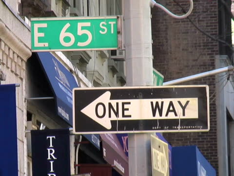 ms east 65th street and one way street signs/ new york city - one way stock videos & royalty-free footage