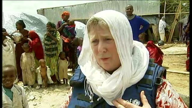 AlShabaab maintains ban on western aid agencies Rozanne Chorlton and aid worker talking to woman refugee Rozanne Chorlton interview SOT