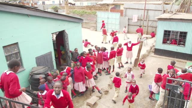 east african children at school - dorf stock-videos und b-roll-filmmaterial