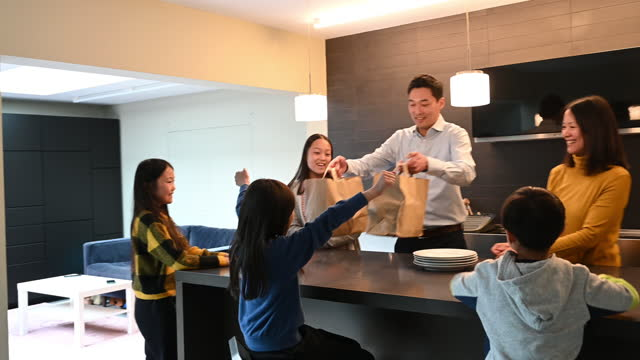 east asian family excited about takeout food for dinner - 12 13 years stock videos & royalty-free footage