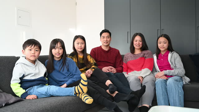 east asian parents and young children together on sofa - 12 13 years stock videos & royalty-free footage