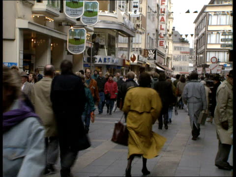 daily life after wall opens 01 w germany bonn ext vs bonn from across river vs people walking along streets loaded fruit stall trams along prosperous... - east berlin stock videos and b-roll footage