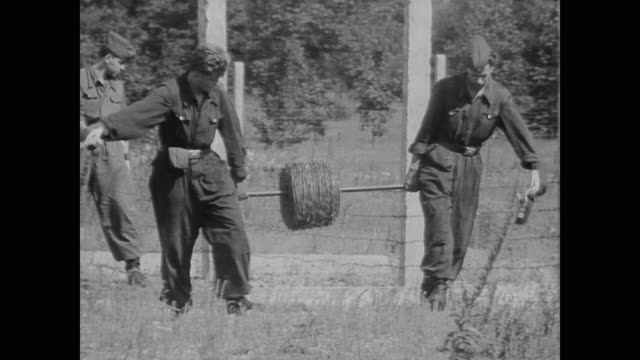 east berlin military lay barbed wire erect posts and guard the border as they close the berlin wall boundary - kampfpanzer stock-videos und b-roll-filmmaterial