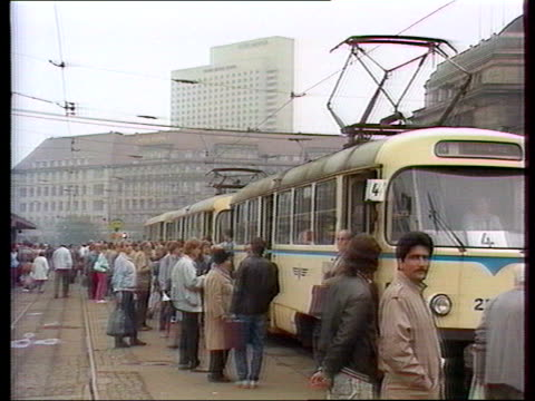 east berlin: protests; ext leipzig people alighting from tram - tram stock-videos und b-roll-filmmaterial
