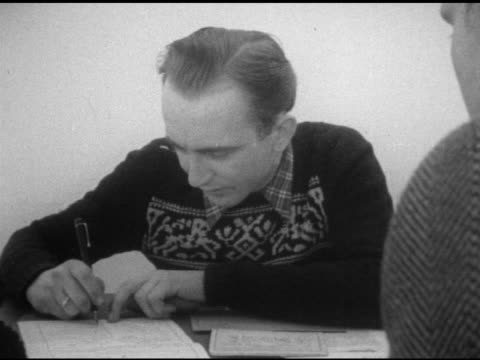 east berlin refugees conducting interview male filling out forms various refugees stamping fingerprints berlin wall occupied city - rifugiato video stock e b–roll