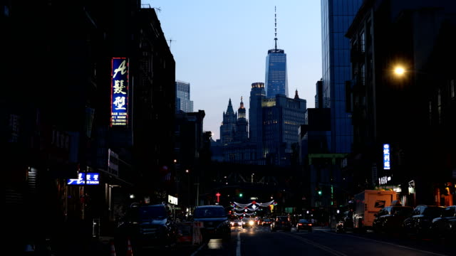 east broadway chinatown dusk - one world trade center stock videos & royalty-free footage