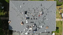 East Brunswick NJ US. 20 JUNE 2020: Construction worker on a renovation roof the house installed new shingles
