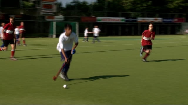 east end children train with british olympic hockey team; graphicised sequence boys putting on hockey masks, putting in gum shields and leaving... - television game show stock videos & royalty-free footage