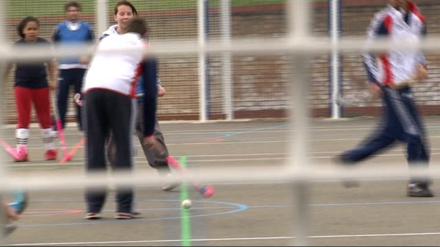 east end children train with british olympic hockey team; tx 4.4.2011 london: newham sixth form college: ext schoolgirl using hockey stick to keep... - schoolboy stock videos & royalty-free footage