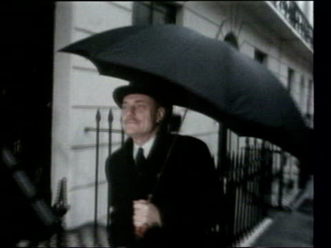 east europeans eligible to travel and work in eu lib enoch powell walking along holding umbrella / int b/w footage enoch powell speaking at meeting... - enoch powell stock videos & royalty-free footage